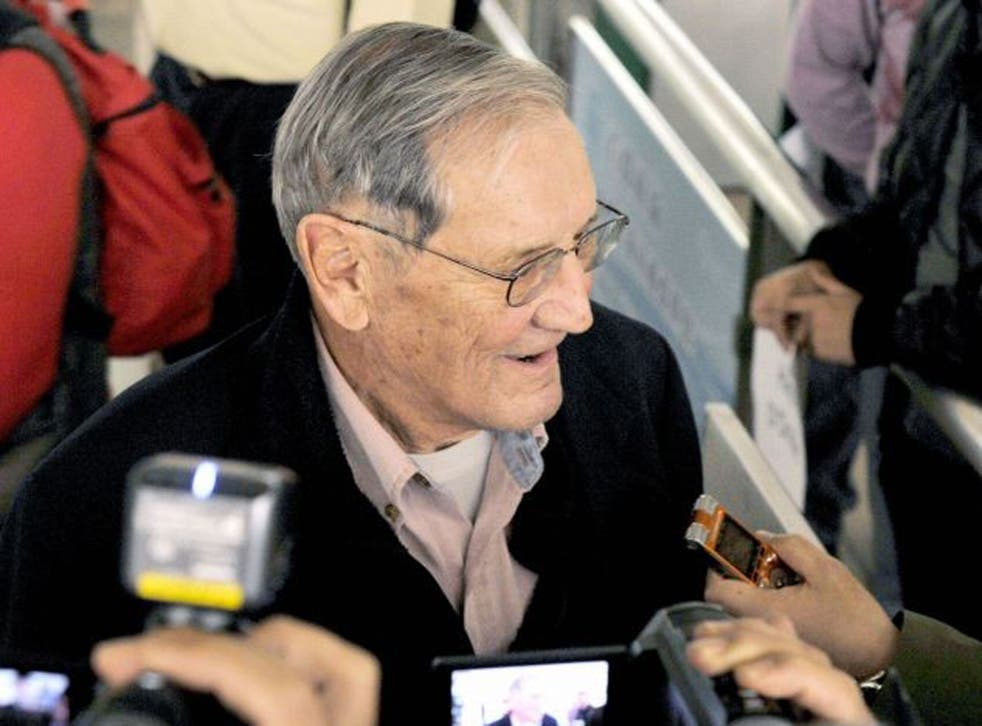 Merrill Newman speaks with reporters after landing in Beijing