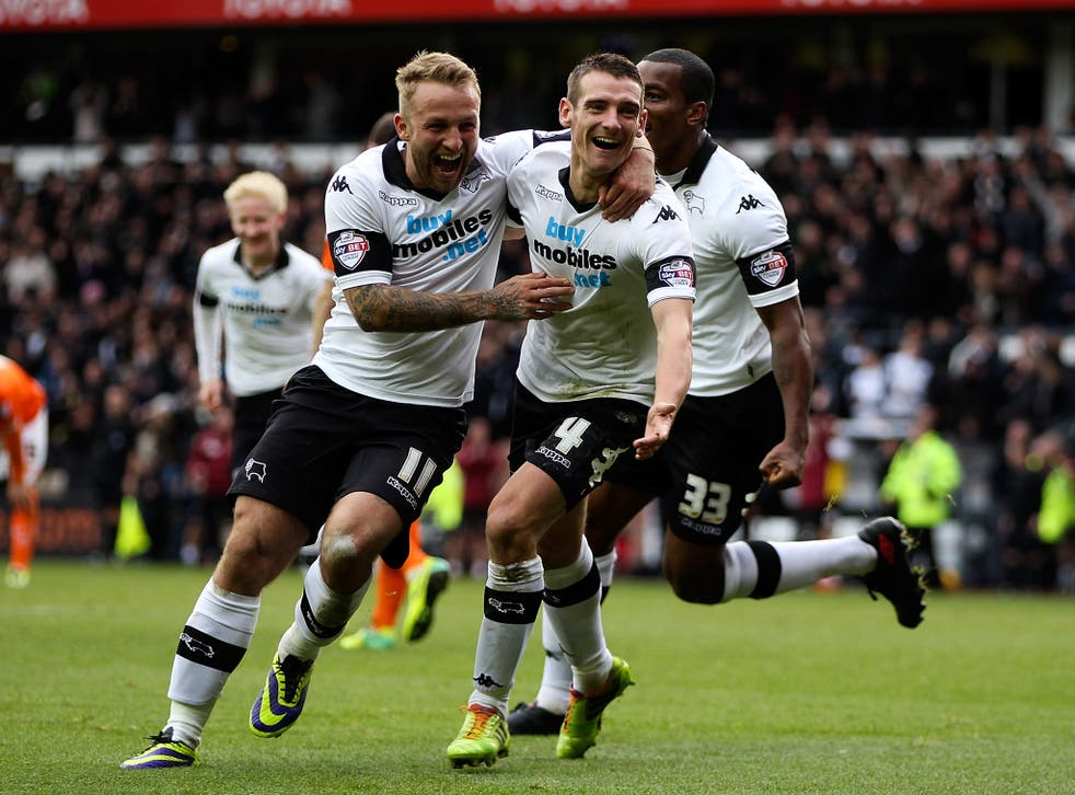 Derby County celebrate after Chris Bryson scores