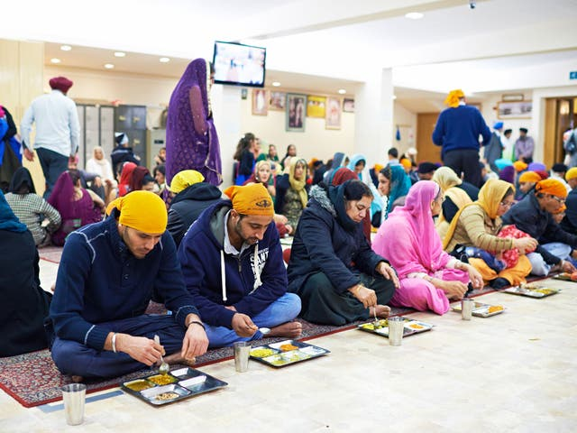 Free vegetarian food is served at the Sikh temple in Ilford, Essex