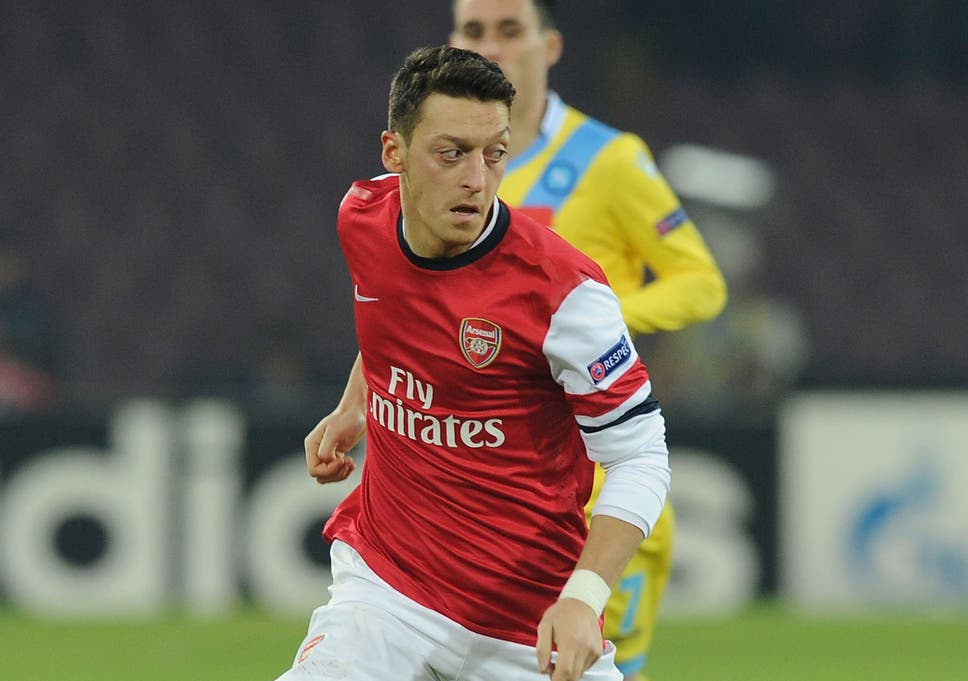 110821b29 Mesut Ozil turns on the ball during Arsenal s 2-0 defeat against Napoli on  Wednesday
