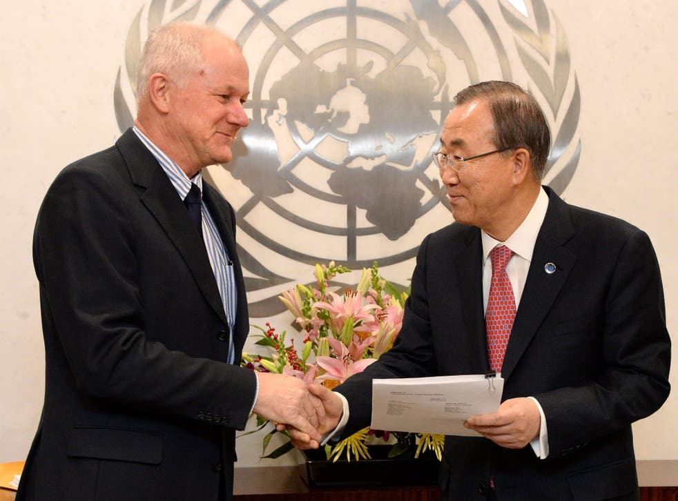 United Nations Secretary-General Ban Ki-moon, right, receives a report about the alleged use of chemical weapons in Syria from Ake Sellstroem