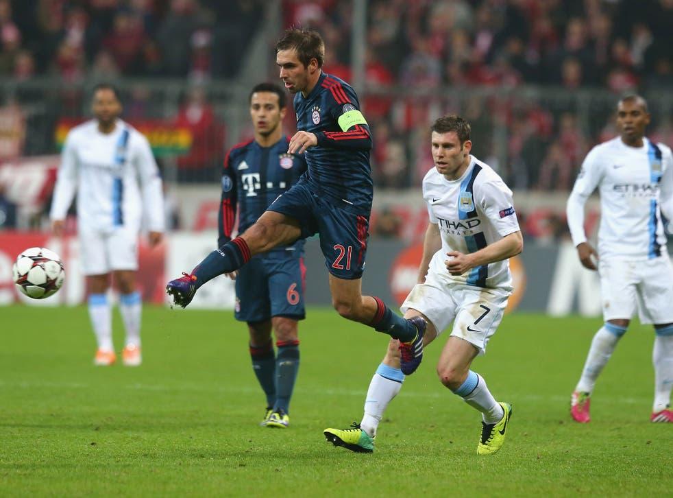 Philipp Lahm of Bayern Munich runs with the ball