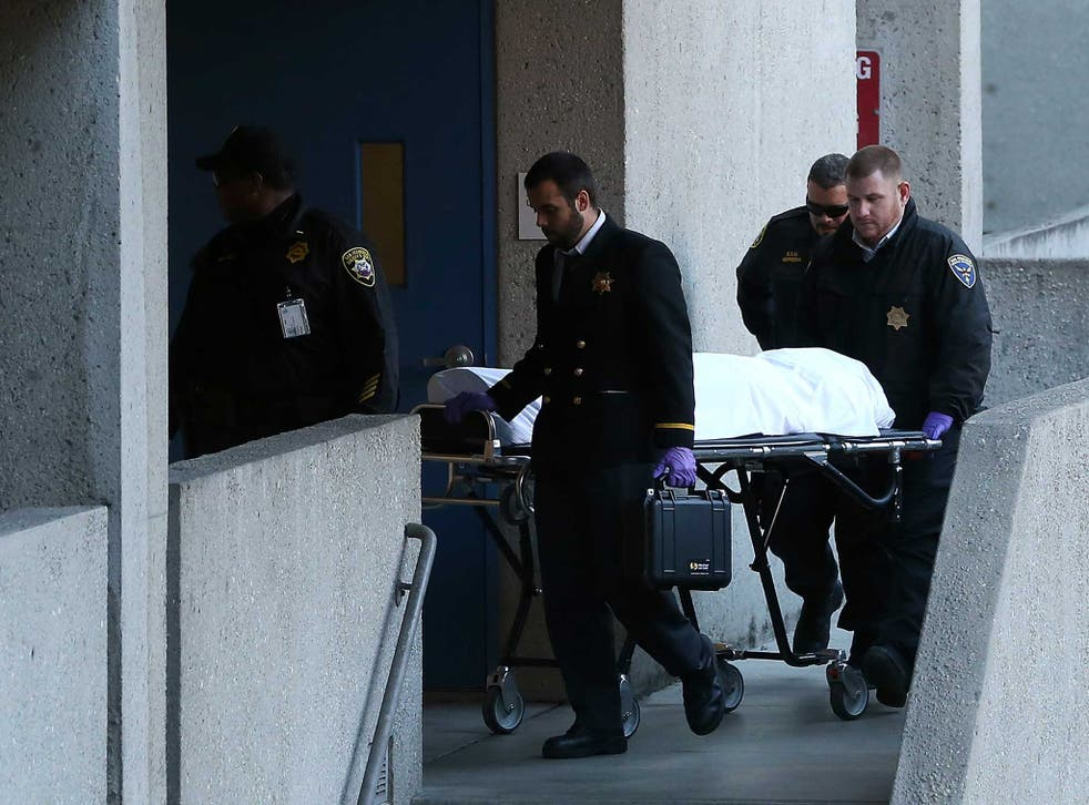 The San Francisco medical examiner moves the body of Lynne Spalding on a gurney at San Francisco General Hospital
