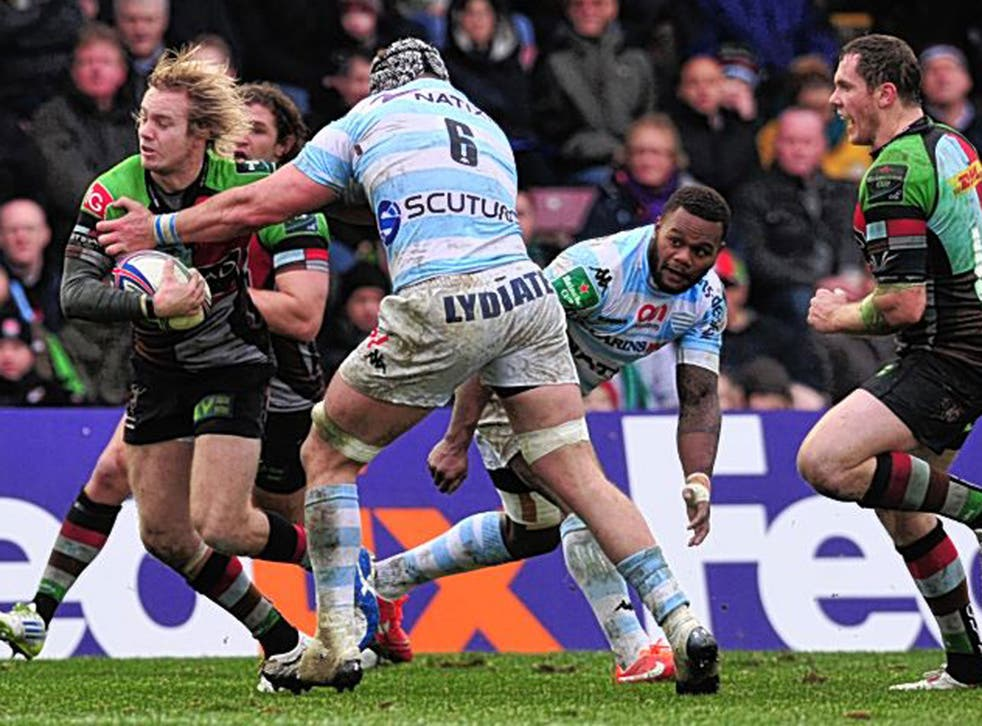 Harlequins' Charlie Walker breaks a tackle to score a try against Racing Metro