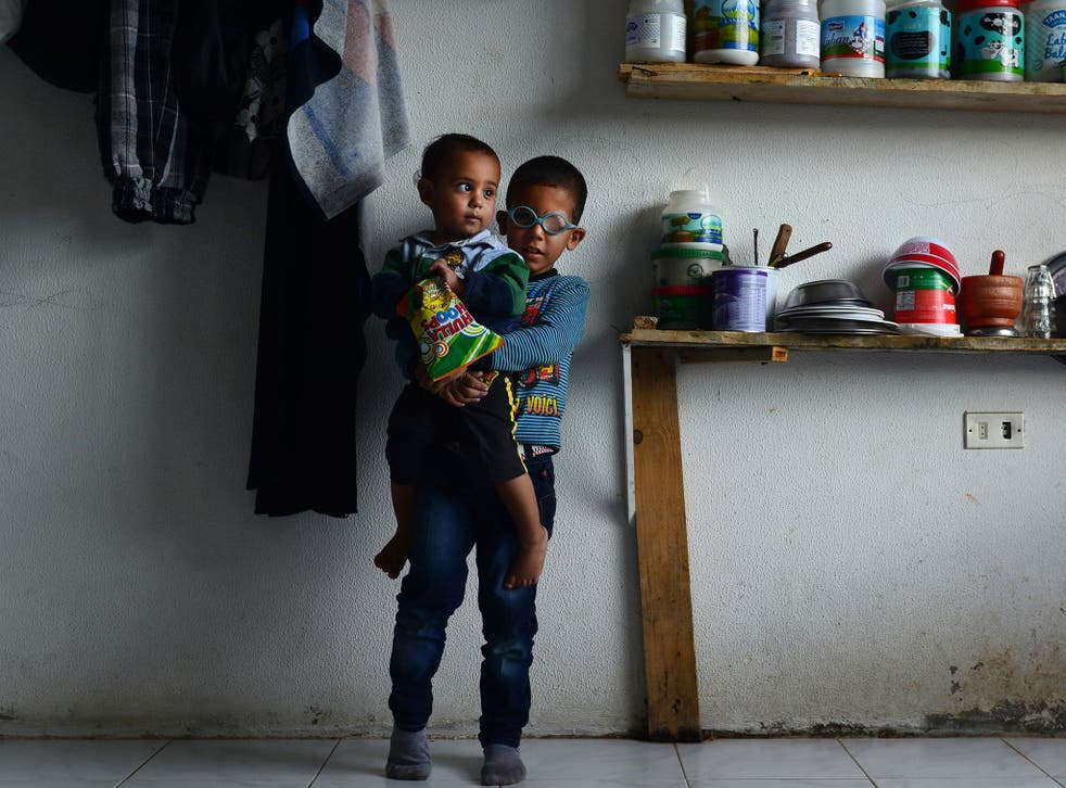 Refugees Mohammad al-Khalid, four, and his brother Ahmed, one, are both battling eye cancer