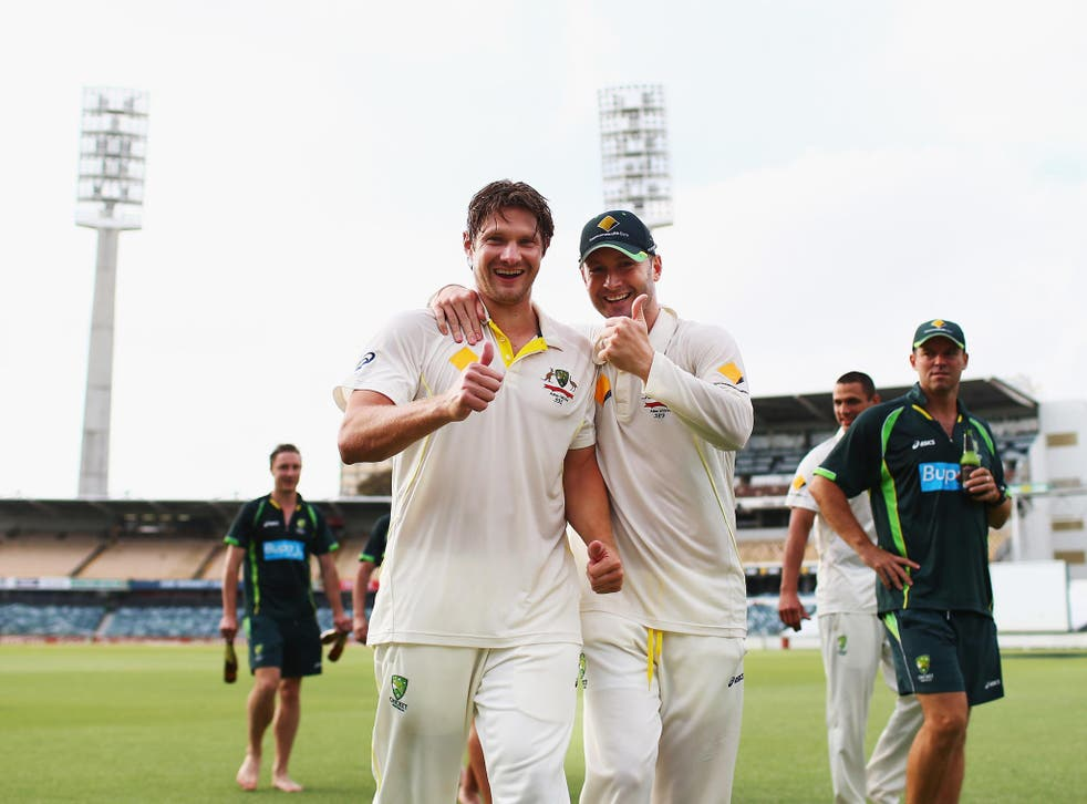 Michael Clarke and Shane Watson of Australia celebrate on the pitch after day five of the Third Ashes Test Match between Australia and England