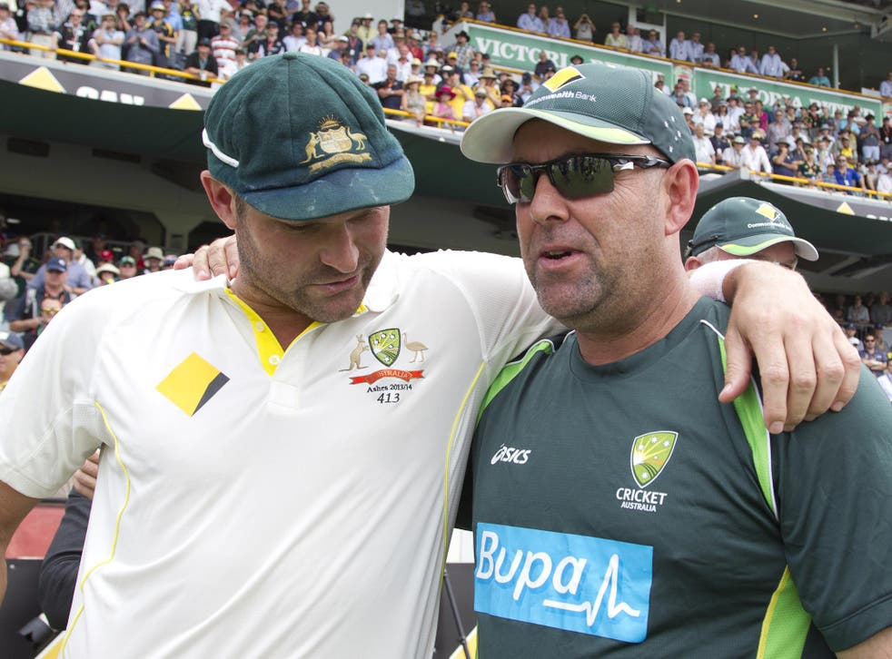 Australian cricket coach Darren Lehmann (R) celebrates with bowler Ryan Harris (L) after winning back the urn from England on the fifth day of the third Ashes cricket Test match in Perth