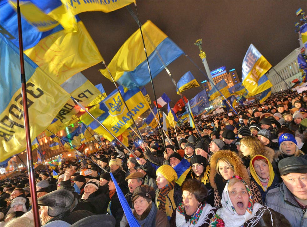 Ukrainian protesters shout slogans during a mass opposition rally in Independence Square in Kiev