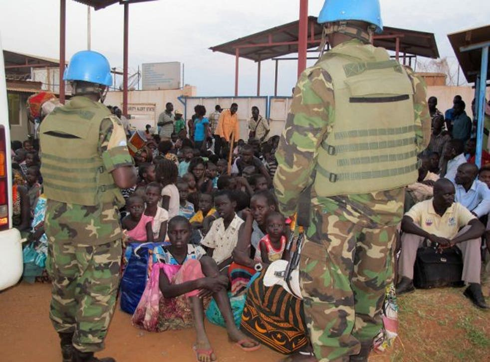 Civilians take shelter at the UN Mission compound on the outskirts of Juba