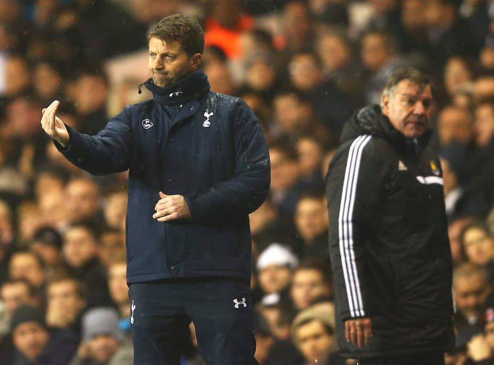Tottenham's new man in charge Tim Sherwood follows the action alongside the West Ham manager, Sam Allardyce