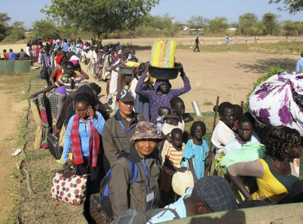Civilians arrive for shelter at the United Nations Mission in the Republic of South Sudan (UNMISS) compound in Bor, South Sudan in this December 18, 2013