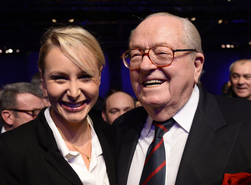Jean-Marie Le Pen with FN deputy Marion Marechal-Le Pen in November of this year - the former leader of the FN has suggested Romanians are 'naturally' inclined to stealing