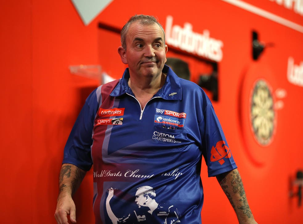 Phil Taylor walks off stage after he's beaten by Michael Smith in the Darts World Championship