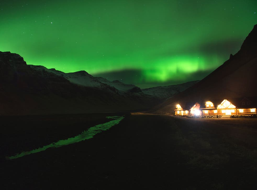 Picture taken on November 8, 2013 showing the northern lights or aurora borealis near the village of Vik, in southern Iceland.