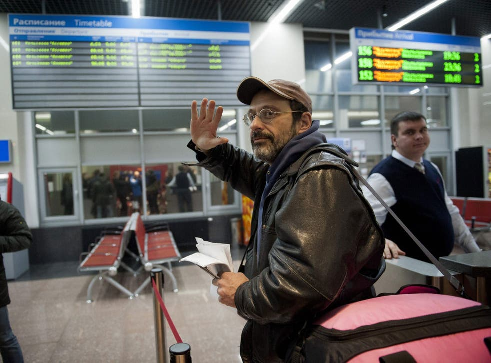 Dima Litvinov became the first member of the so-called 'Arctic 30' to leave Russia; boarding a train at a railway station in St. Petersburg