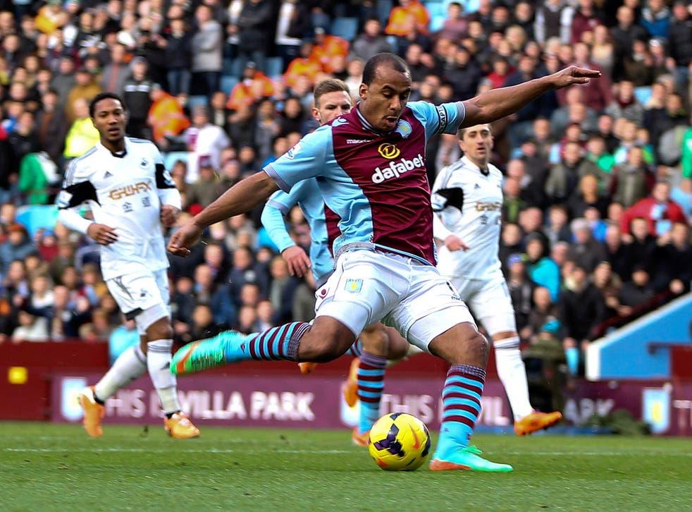 Aston Villa striker Gabriel Agbonlahor scores against Swansea City