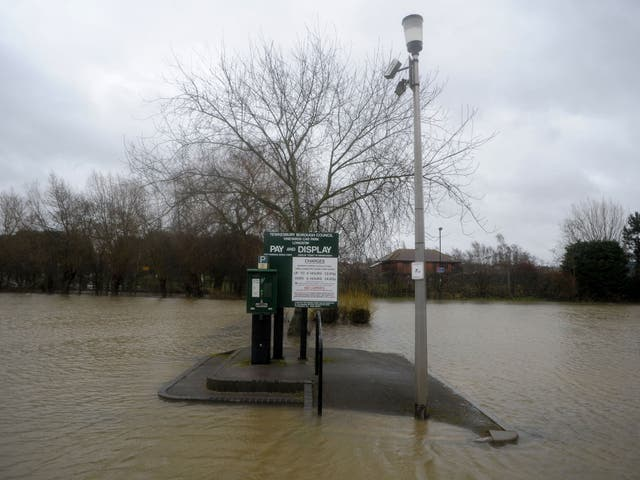 A flooded car park nearTewkesbury Cathedral in Gloucestershire as heavy rain and strong winds continue across the country