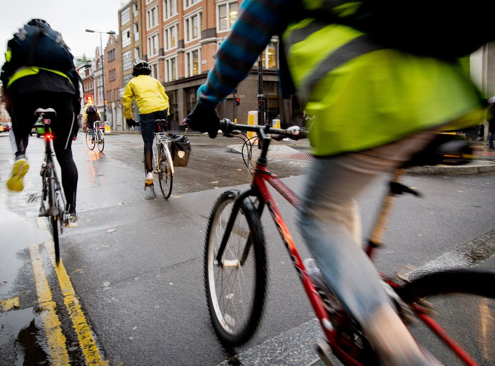 Cyclists ride in central London where the proposed SkyCycle routes would be built