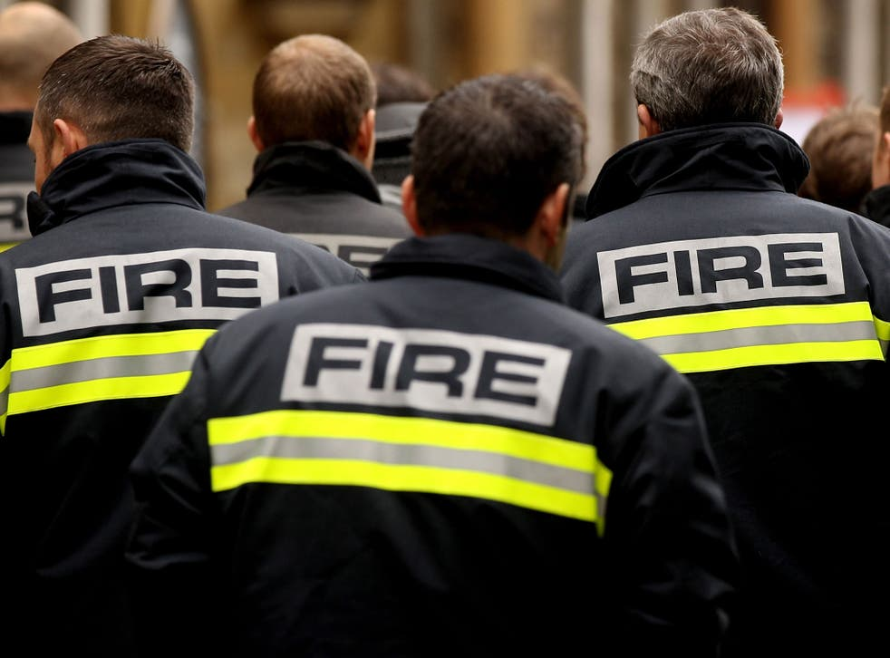 Firefighters arrive to attend a meeting of the Fire Brigades Union in London.