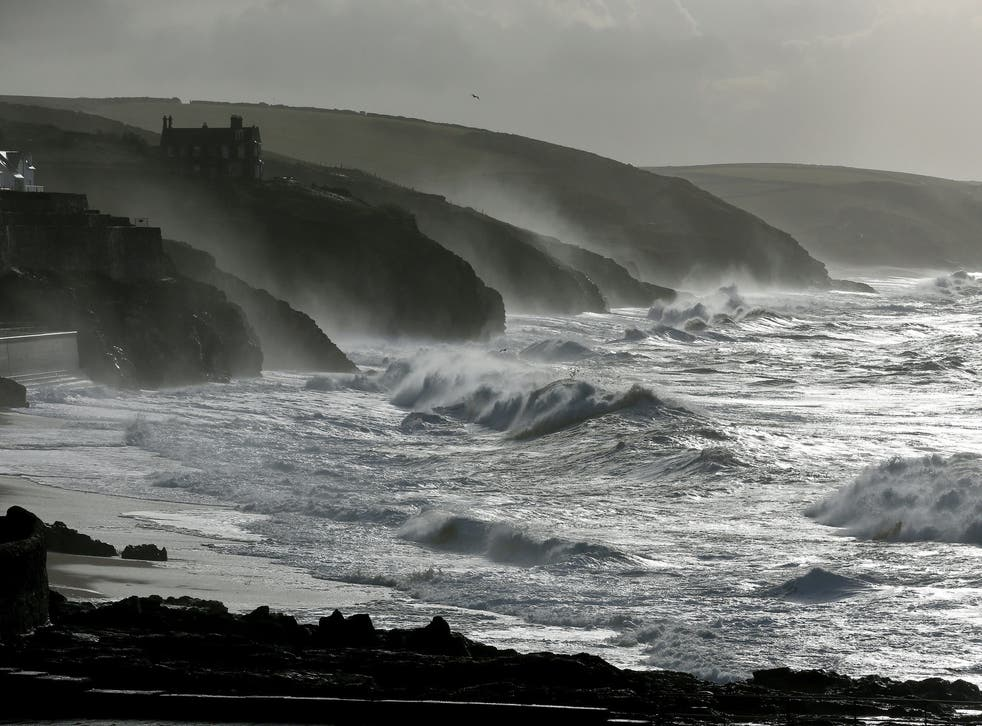 Large waves break along the coast at Porthleven, Cornwall where a 26-year-old man went missing on New Year's Eve.