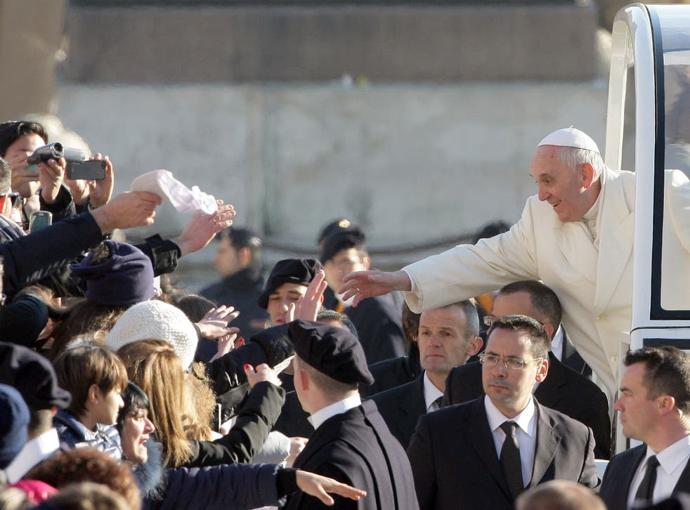 Pope Francis greets the crowd at his weekly Audience in St. Peter's Square in Vatican City.