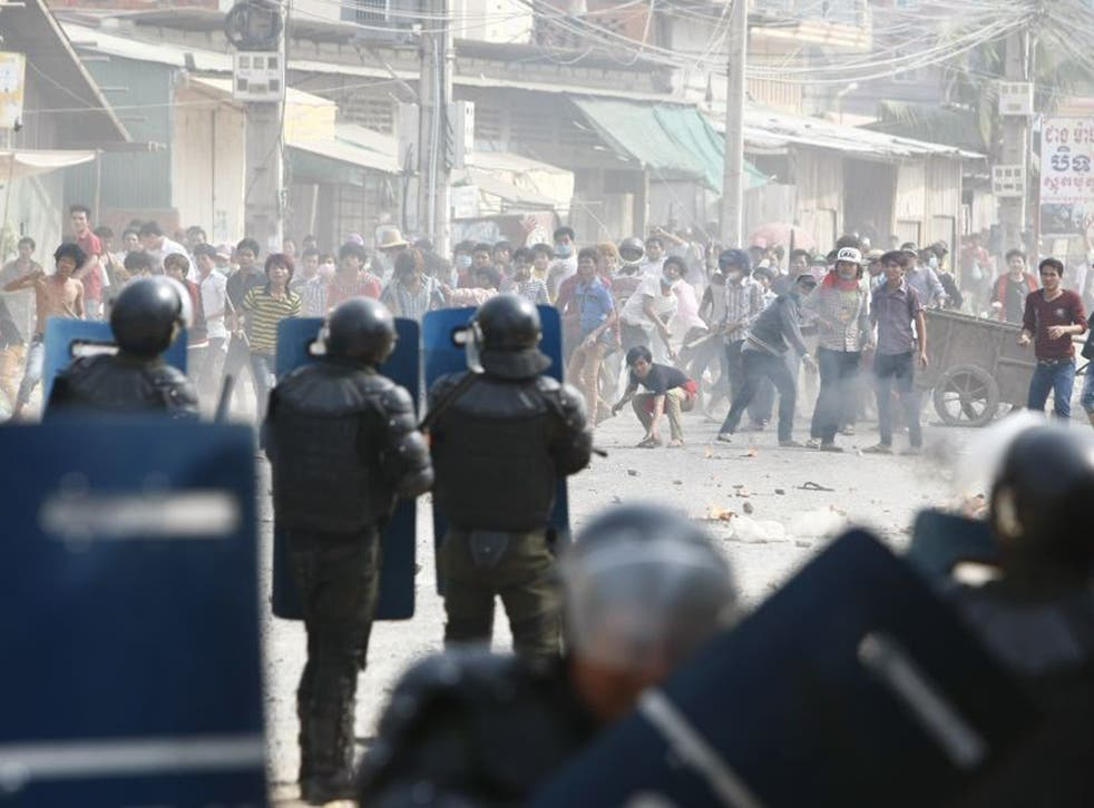 Cambodian riot police prepare to blockade garment workers during a strike near a factory of Canadia Centre, on the Stung Meanchey complex at the outskirt of  Phnom Penh