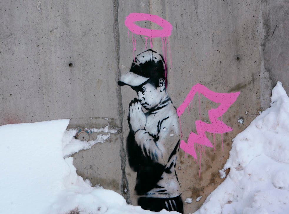 This artwork by Banksy was found covered in brown paint earlier this week