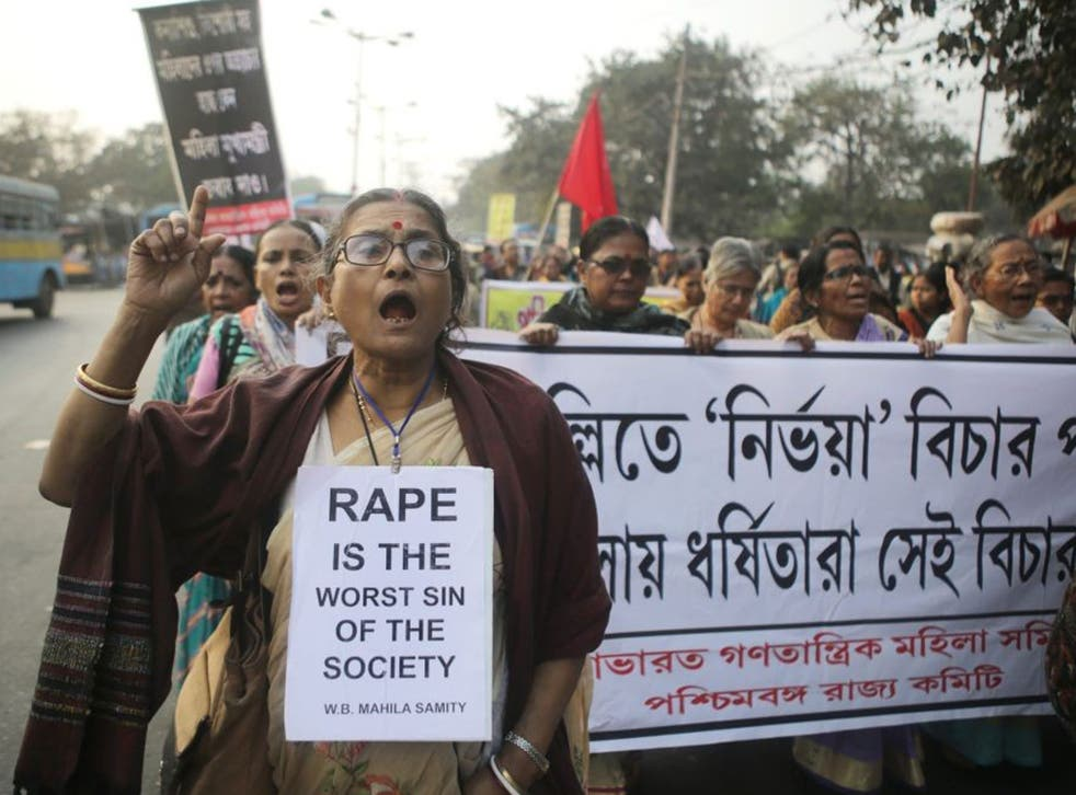 West Bengal Women's Forum activists walk a protest rally against a rape case in Calcutta, eastern India on 03 January 2014. A young girl was gang-raped on October 25 and afterwards repeatedly threatened by the accused, following which the disturbed girl s
