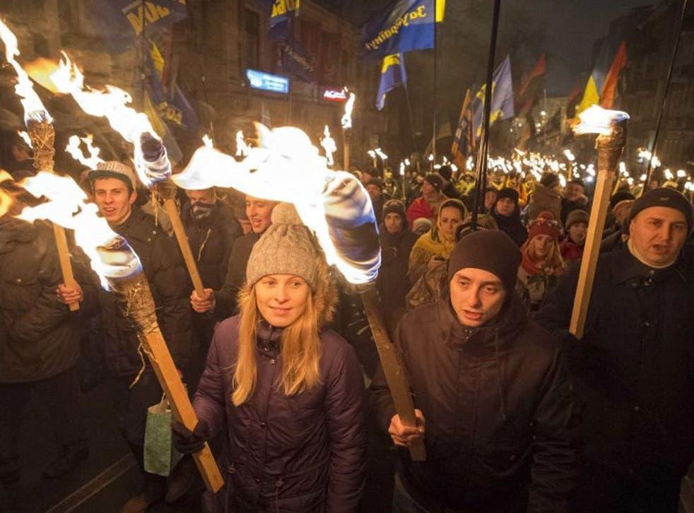 Svoboda members mark the birth date of nationalist