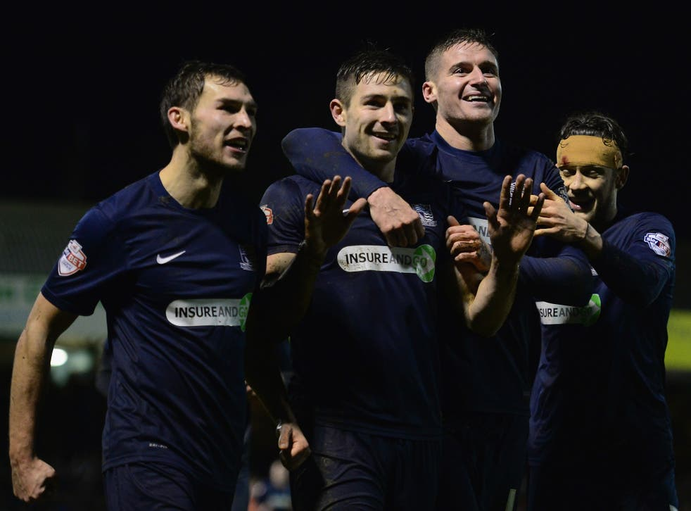Southend players celebrate scoring against Millwall in their 4-1 victory