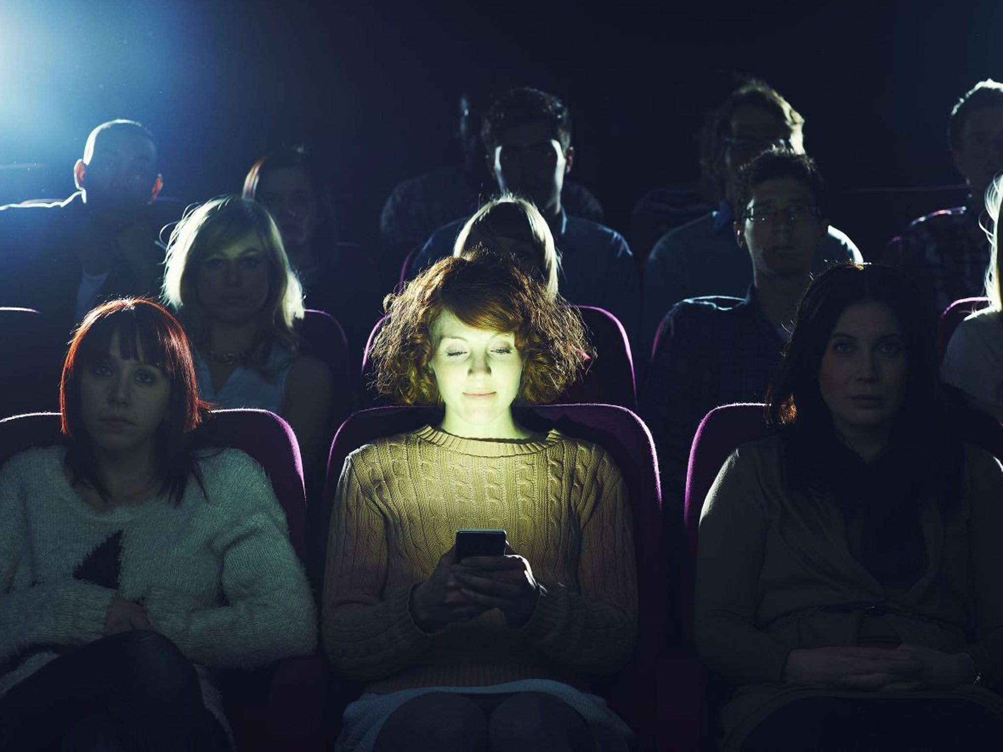 Image result for cinema audience on smart phones