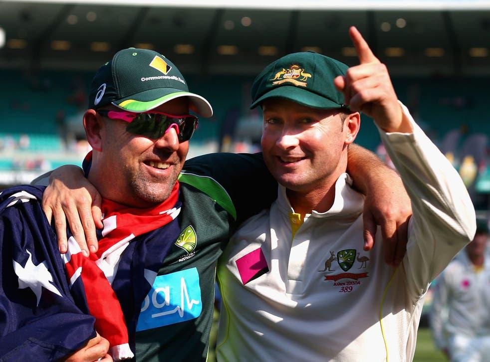 Darren Lehmann (left) celebrates the Ashes triumph with captain Michael Clarke