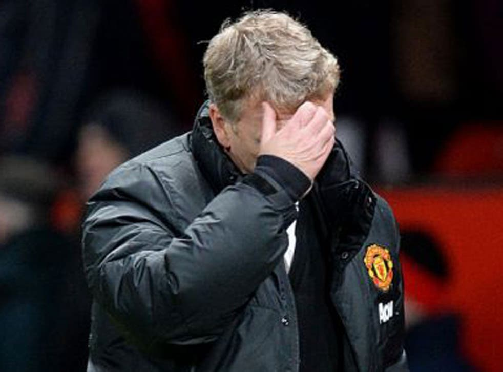 Manchester United manager David Moyes walks off the pitch dejected after the final whistle