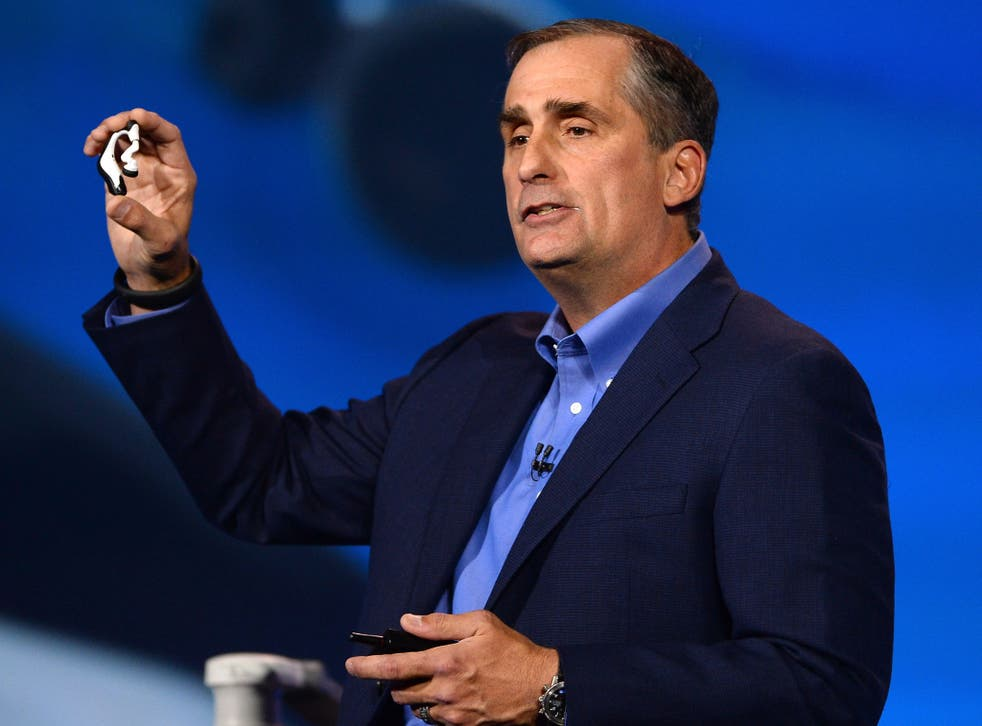 Intel Corp. CEO Brian Krzanich displays the Intel smart headset and earbud designs, providing full stereo audio, heart rate monitor and pulse check, during his keynote address at the 2014 International CES at The Venetian hote