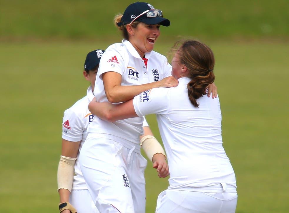 England captain Charlotte Edwards (left) and Anya Shrubsole celebrate the wicket of Australia's Alyssa Healy