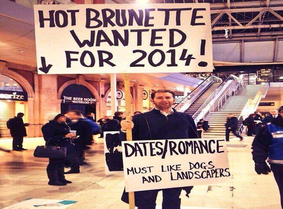 Gerald Abrahams dons his placard at Waterloo station