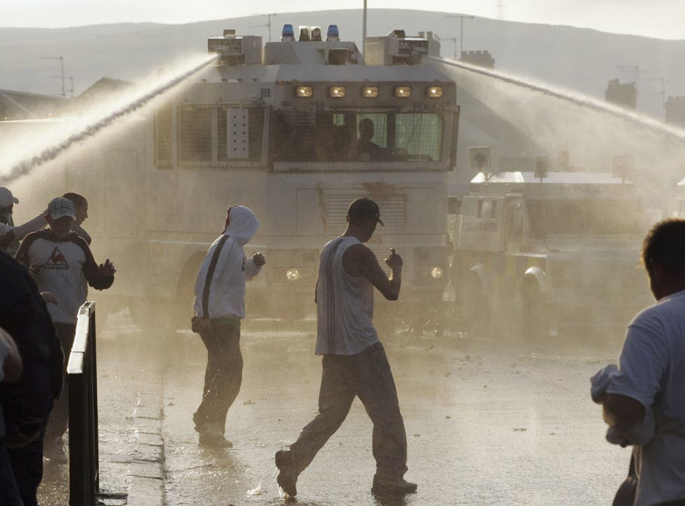 PSNI (Police Service of Northern Ireland) use a water cannon during riots on the Crumlin Road in 2005 in north Belfast