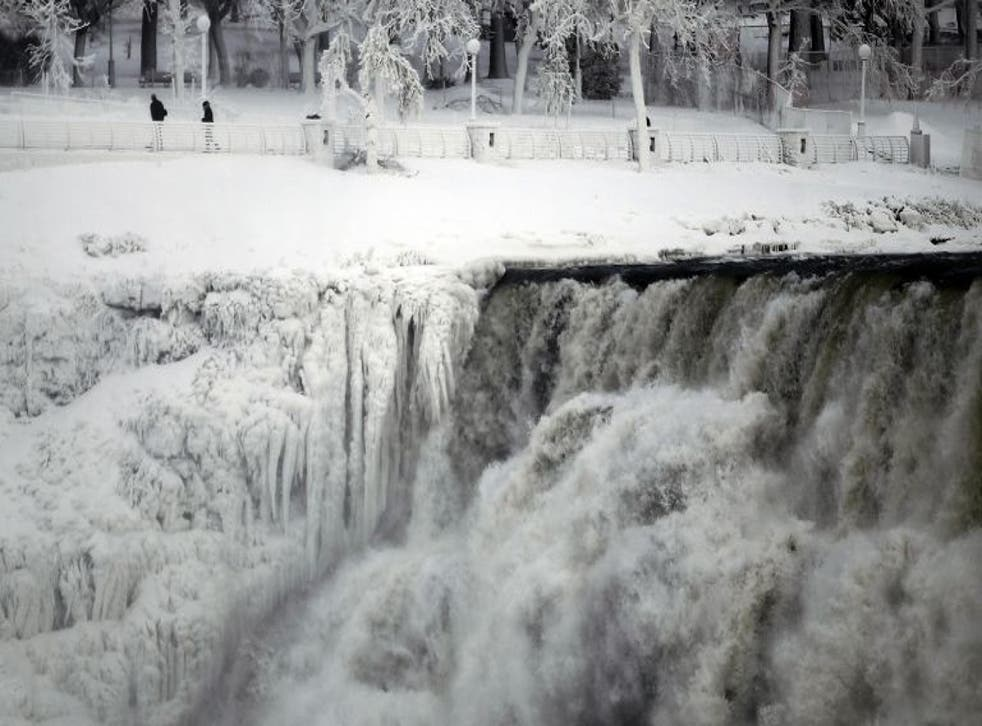 """The US side of the Niagara Falls is pictured in Ontario, 8 January, 2014. The frigid air and """"polar vortex"""" that affected about 240 million people in the United States and southern Canada will depart during the second half of this week, and a far-reaching"""