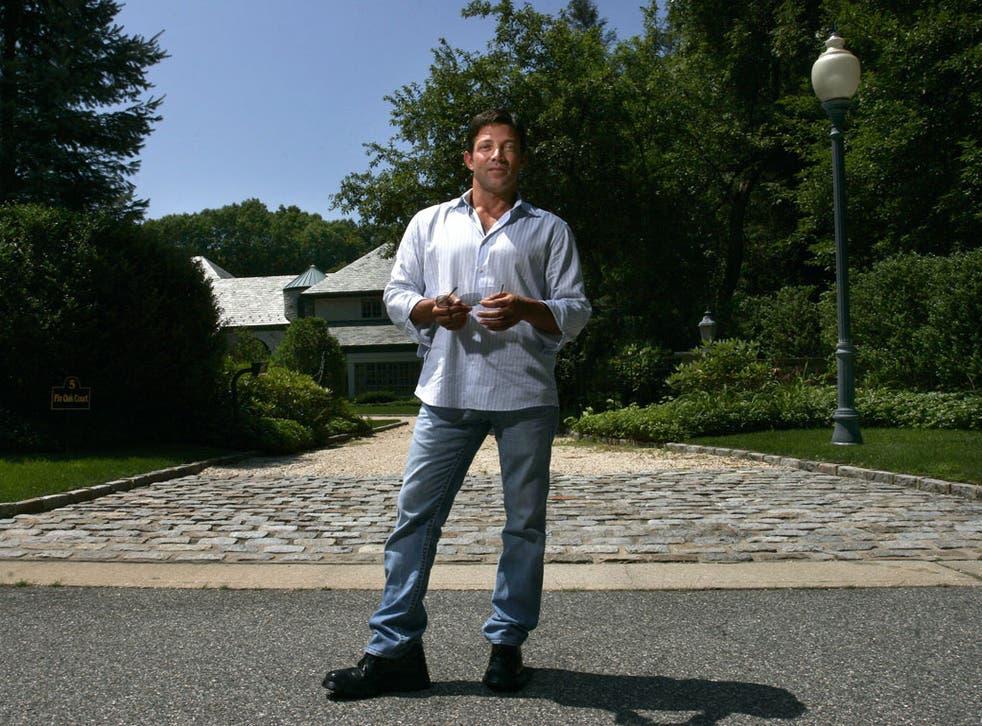 Jordan Belfort stands outside his former home