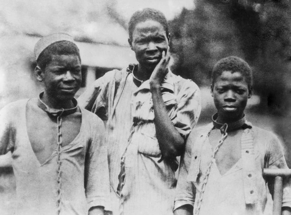 Chain reaction: Abyssinian slaves forced to wear iron collars, photographed around 1910