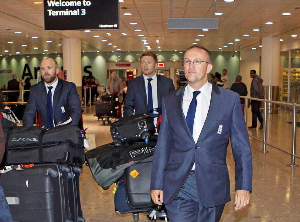 England's (from left) Matt Prior, Jonny Bairstow and Andy Flower arrive back at Heathrow on Thursday
