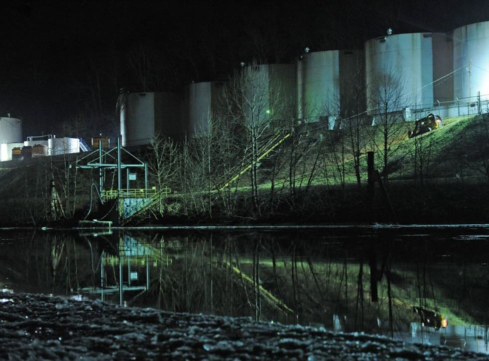 Crews clean up a chemical spill along the Elk River in Charleston, West Virginia