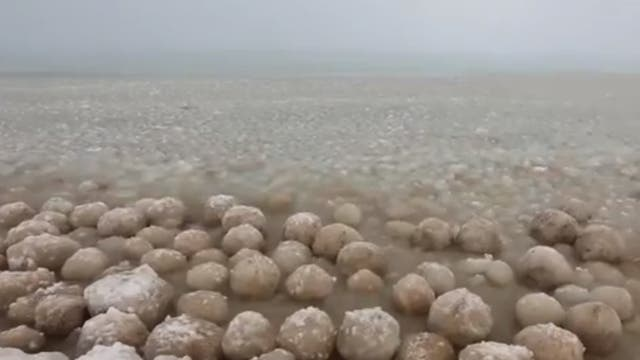 Ice balls washing up on the shores of Lake Michigan as the US is plunged into sub zero temperatures