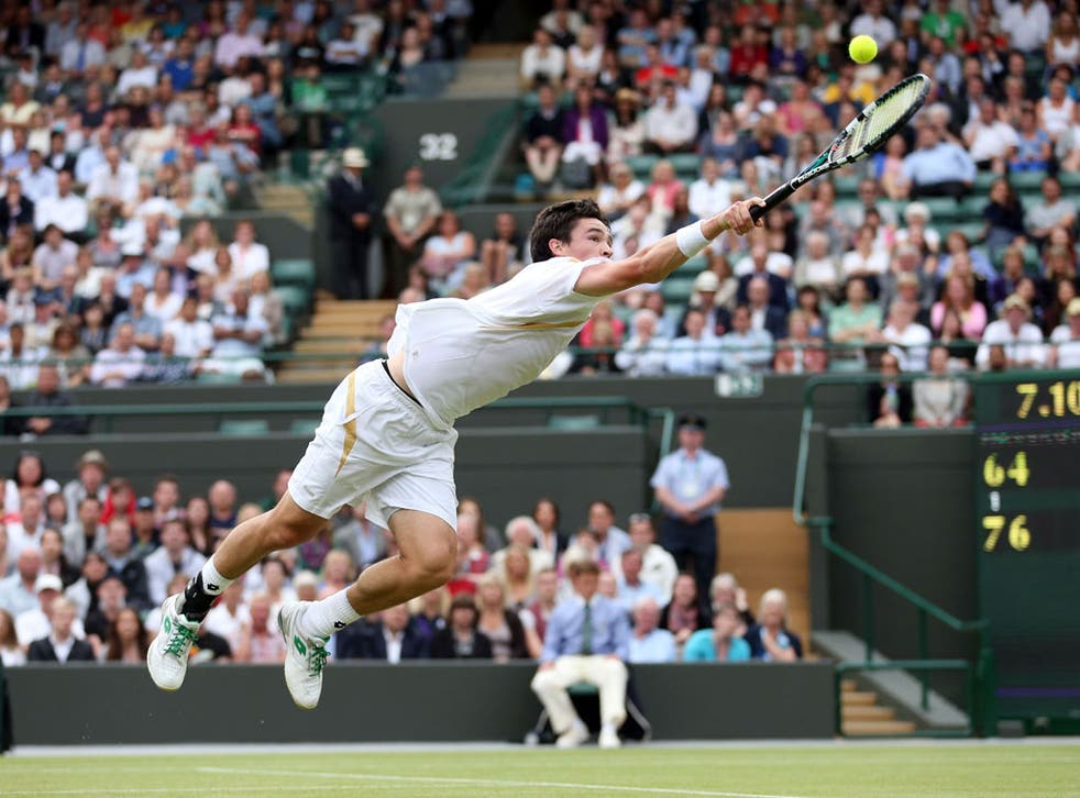 Jamie Baker dives for a backhand against Andy Roddick at Wimbledon, 2012