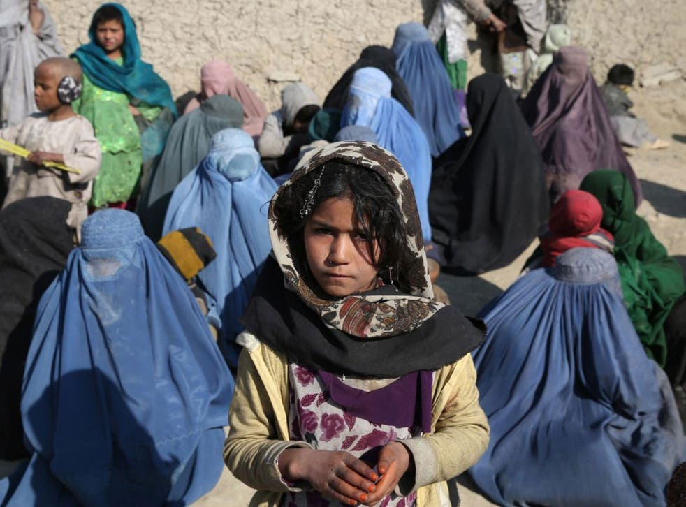 Cold comfort: Afghans wait to receive winter aid in Kabul last weekend