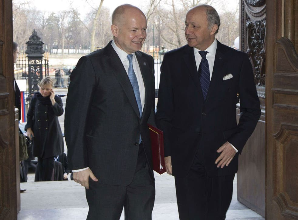William Hague, left, with French Foreign Minister Laurent Fabius, right, said there had been no 'systematic' torture by British troops