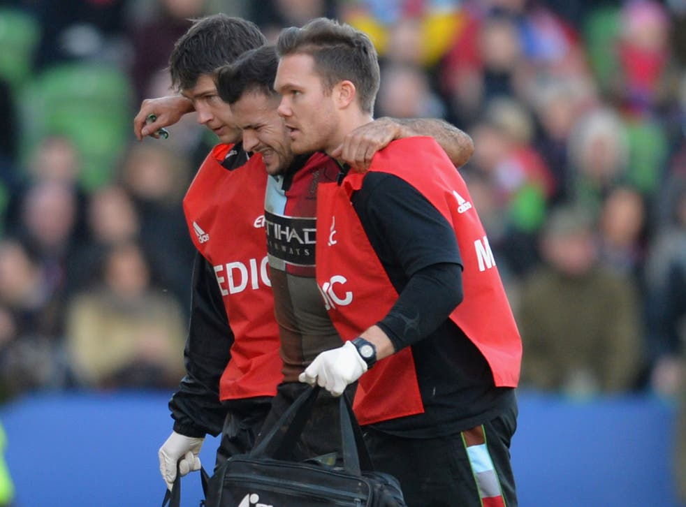 Danny Care is helped off the field