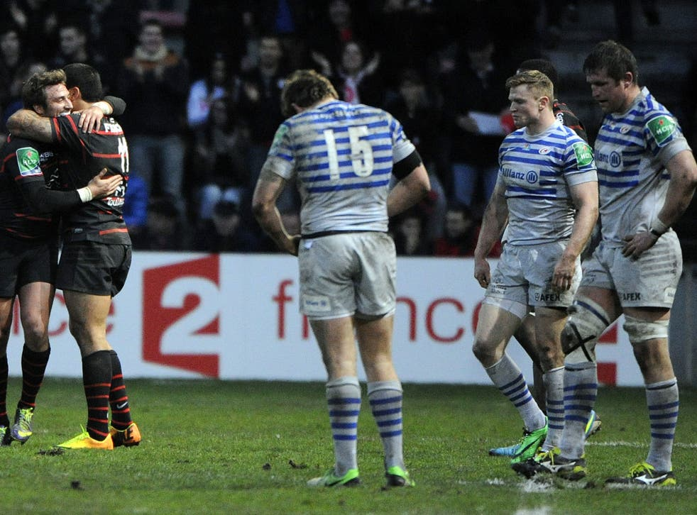 Alex Goode, Chris Ashton and Ernst Joubert of Saracens look dejected after defeat to Toulouse
