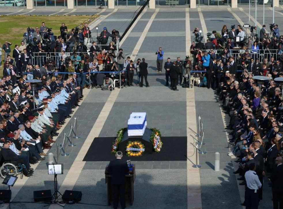 Israeli PM Benjamin Netanyahu speaks during a state memorial service for Israel's former Prime Minister Ariel Sharon at Israel's parliament, the Knesset on 13 January 2014 in Jerusalem, Israel