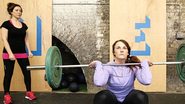 Worth the weight: Alice Klein (wearing black and pink) and experienced CrossFitter Lauren Dagger